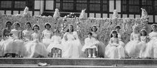 Included a May queen, a court, train bearers and a May pole dance